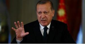 أردوغان يطالب أميركا بالتزام حدها