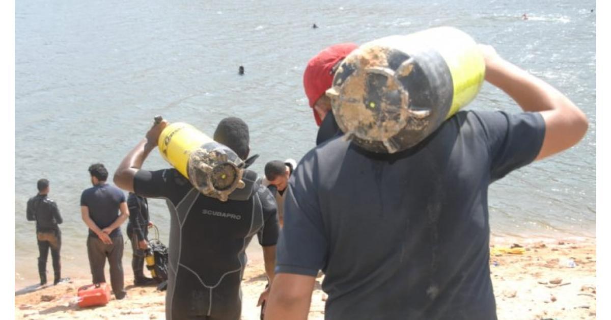 الدفاع المدني يواصل البحث عن غريق داخل سد الملك طلال (صور)