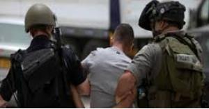 اعتقال 14 فلسطينيا في الضفة الغربية