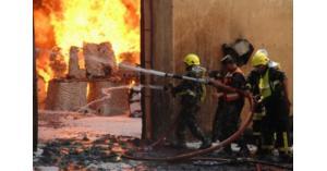 الدفاع المدني يخمد حريق محل لدهان المركبات في العاصمة