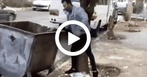 """شاهد  بالفيديو.. شاب يلقي أحد الأطفال في الـ""""حاوية"""""""